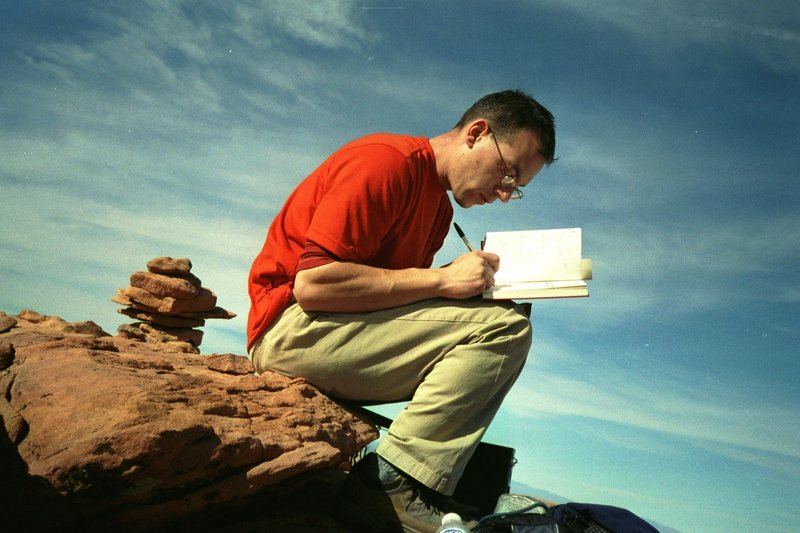 Signing the register atop Windy Peak, Red Rocks