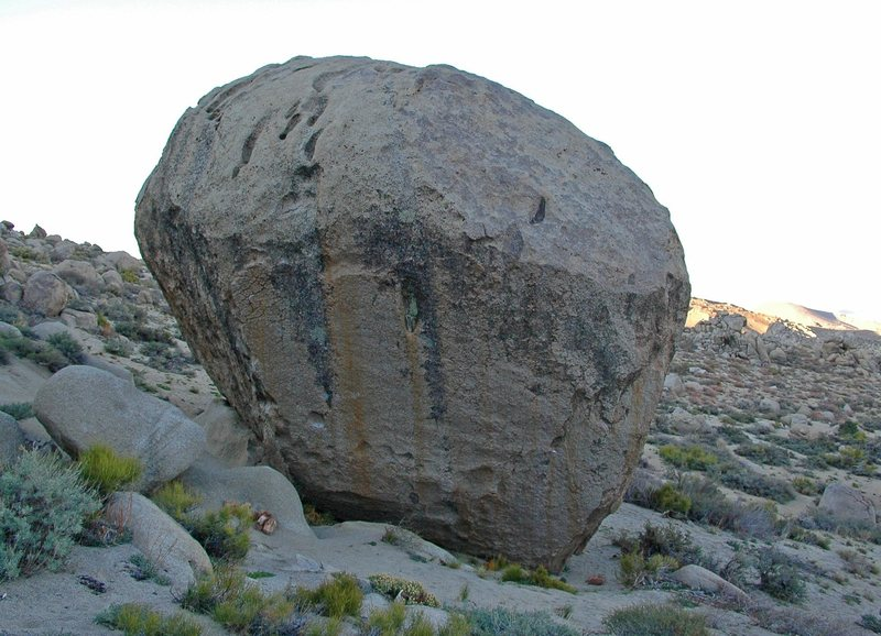 South face of the 'Beekeeper Boulder'.  Left arete is 'Golden Shower', v10.  Right arete is 'Mesothelioma', v7