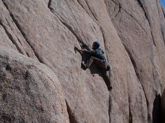 Rock Climbing Photo: Bennett puzzles out the start of Leaping Leaner.  ...