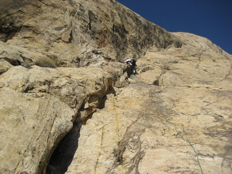 Half way up the 160' first pitch out of the slot canyon. Photo Pat Moe