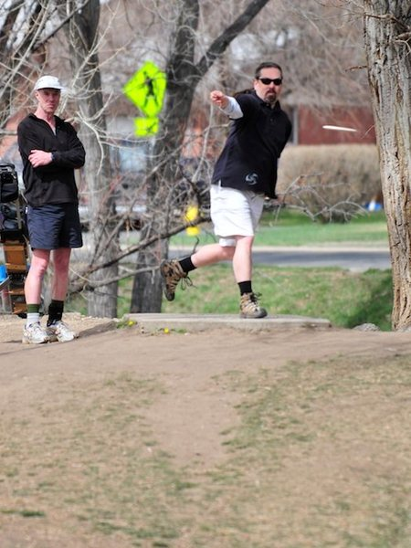 I play a lot of disc golf these days. This is me, and Peter Shive (9 Time World Champion). I was 5 strokes ahead of Peter at this point in the round. He looks like he's going to get serious.