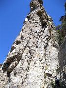 Rock Climbing Photo: Route starts below area shaded by roofs on the lef...