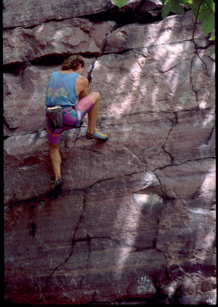 John McMullen bouldering at the Tombstone Wall Area, Devil's Lake, WI. Photo Bob Horan