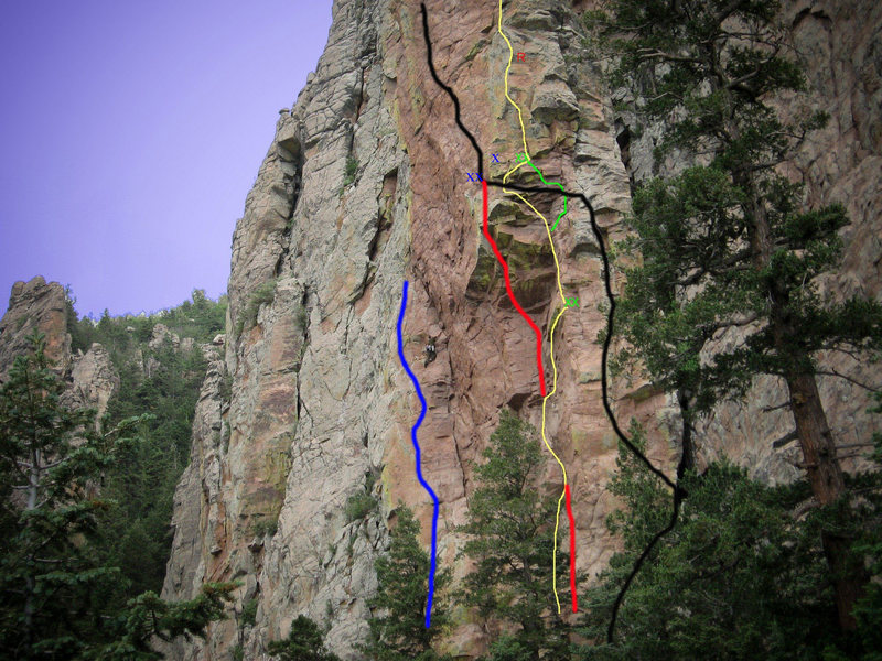 Photo topo of Bush Shark Spire.<br> Blue Line is Feeding Frenzy 5.10<br> Climber is on the Bush Shark Spire Route 5.9<br> Yellow Line is Mudshark App.. 5.11+ R<br> Red Line is Great White 5.13<br> Black Line is Hammerhead 5.12-