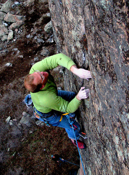 Brandon Patterson entering the second crux.<br> March 2007, Photo by Adam Peters.