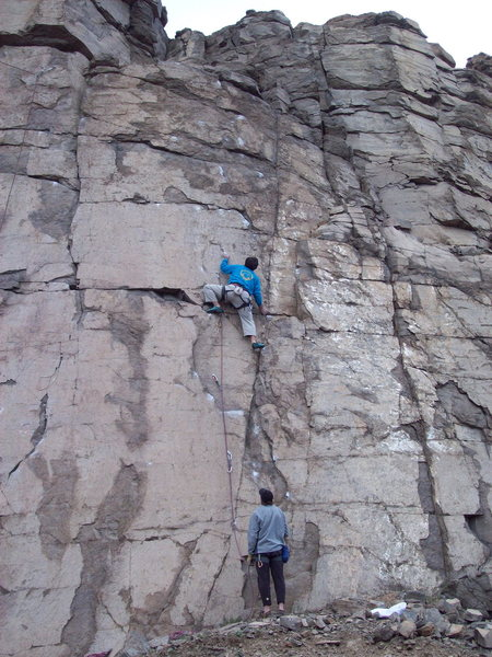 BH on FA of Twilight 5.10d, Sunset, the trad crack is seen just left, Sunrise Wall, Sea Cliffs of North Quarry, North Table Mountain, Golden, CO.