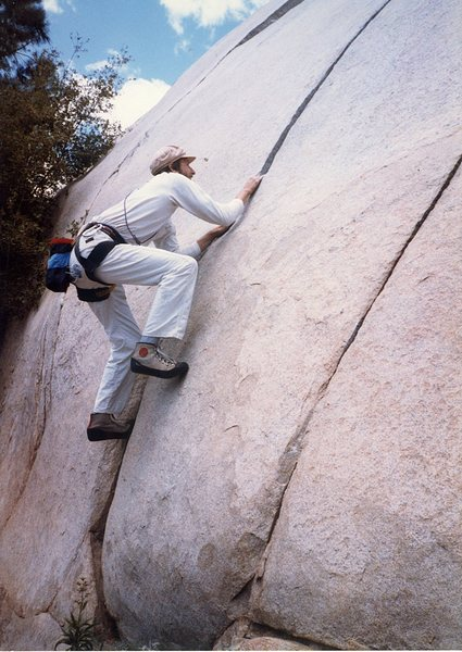 Me at the base of the Kernville Slabs in the 80's . Nice crack.