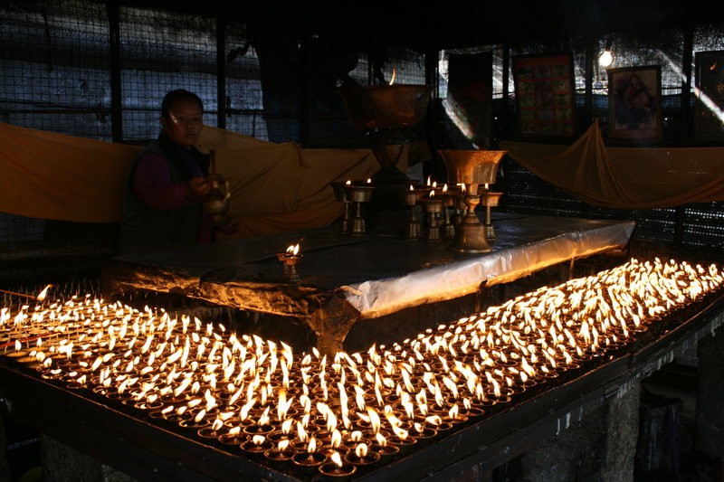 Prayer candles being prepared.