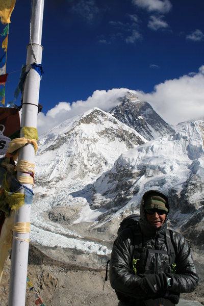 On the summit of Kala Pathar with Everest in the background