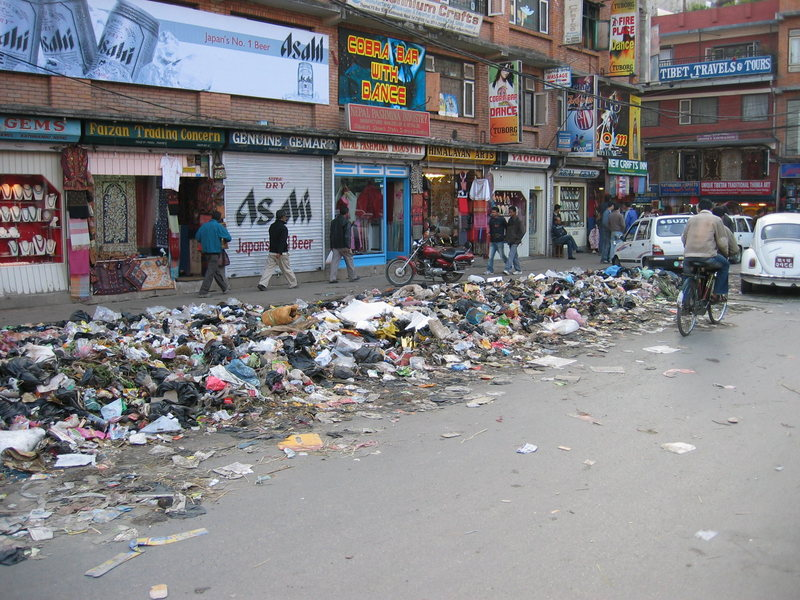 Typical street scene in Kathmandu. Sometimes the trash is collected after it's been picked through by the animals. Other times the piles are burnt in the street in the early hours of the morning.