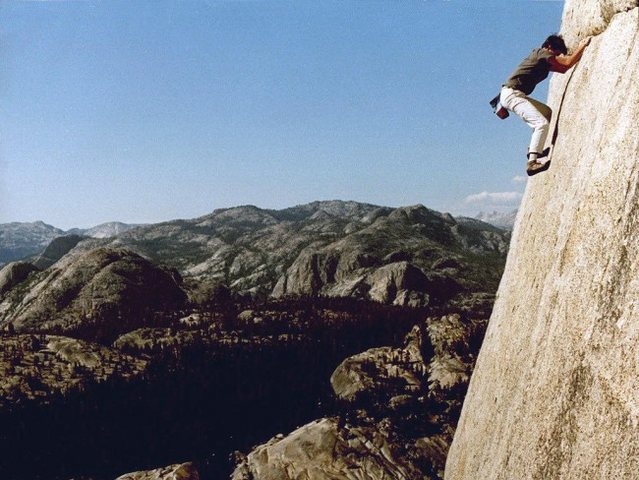 Paul Parker on a solo of On the Lamb 5.9, a 500 foot long traverse on Lamb Dome - Tuolumne Meadows, Yosemite NP<br>