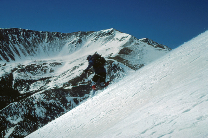 Colorado offers excellent backcountry spring skiing on its 12,000'-14,000' peaks. The east face of Stanley Mountain near Berthoud Pass. May 1986