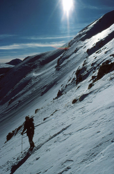 Powder is rare above timberline in mid-winter. Skiing breakable crust on Bear Mtn in the Sts. John cirque near Montezuma, CO. December 1985