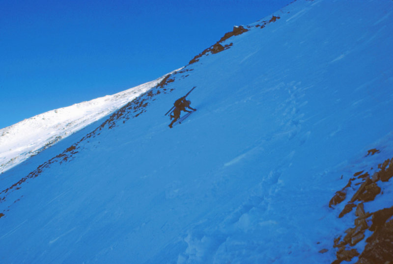 Wendy Weiss kicking steps in windboard while traversing the Continental Divide from Stanley Mtn to Vasquez Pk. Near Berthoud Pass. CO. January 1986