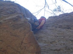 Just after pulling start roof, the only difficult move on this route.