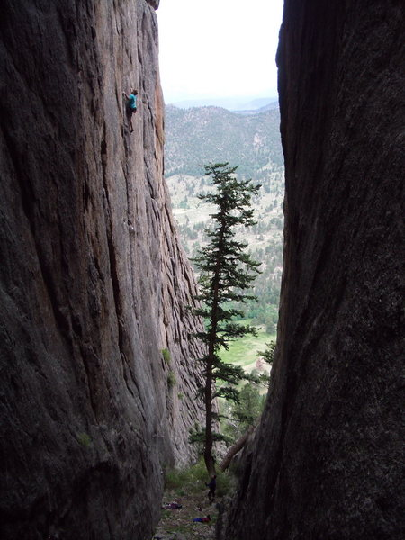 Looking down towards the valley from the Renaissance Wall as Ben Randolph crimps on Dakota (13b).