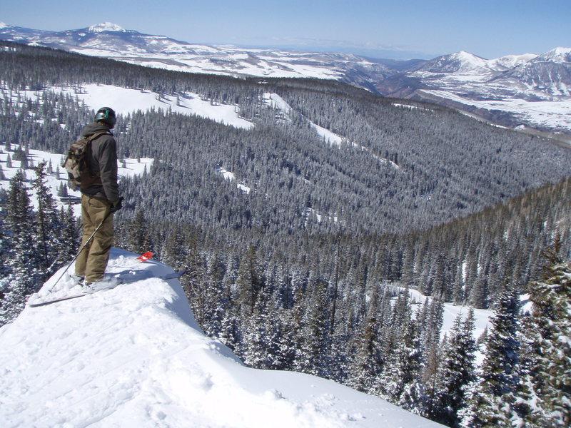 Scott Pittenger on 'Soul Bro Knob'.  The La Sal mountains of Utah on the horizon