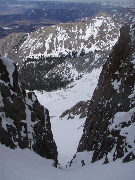 Joe Ryan (builder and CEO of the San Juan Hut System) above the crux while teleing the north face of Sneffels