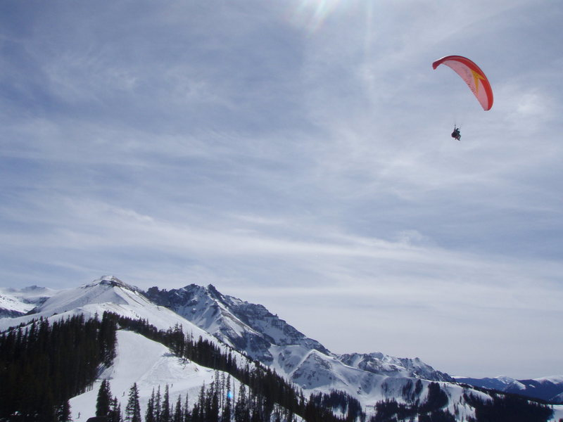 Paraglider with Palymra Pk (13k') in the back at Telluride Ski Resort