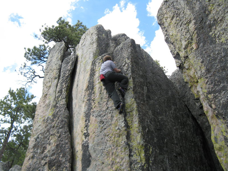 Johnny Walker was the first of us to do this with a rope about 10 years ago. He called it 5.9.  I guess that would make it v0 as a boulder, but I don't really know boulder grades