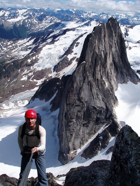 Rob Rappelling off Bugaboo Spire, Snowpatch Spire, in background