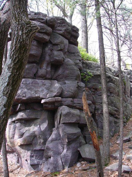 Climb up blocky corner.