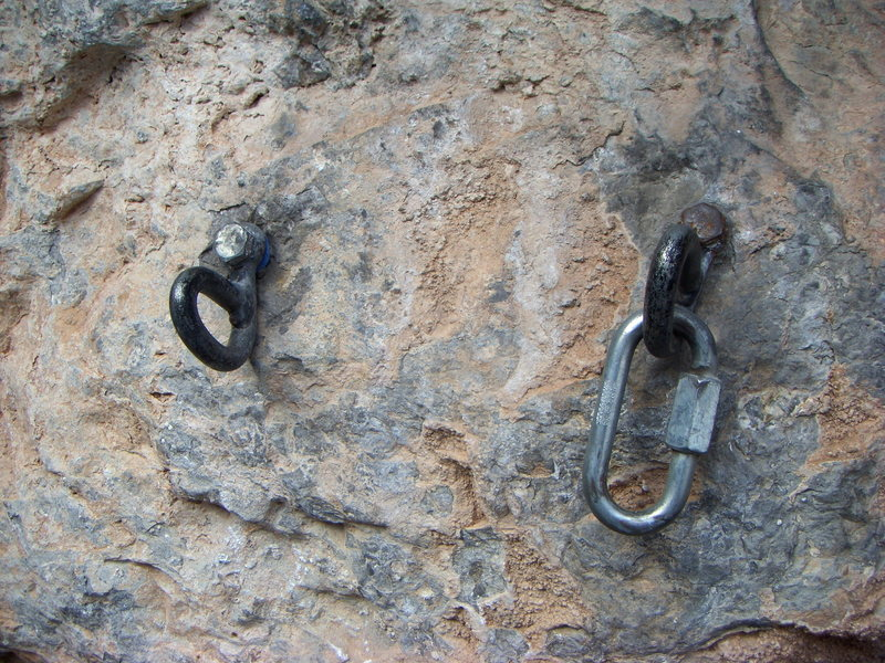 The old belay/rappel anchor for The Long Haul at the Puoux, Glenwood Canyon.