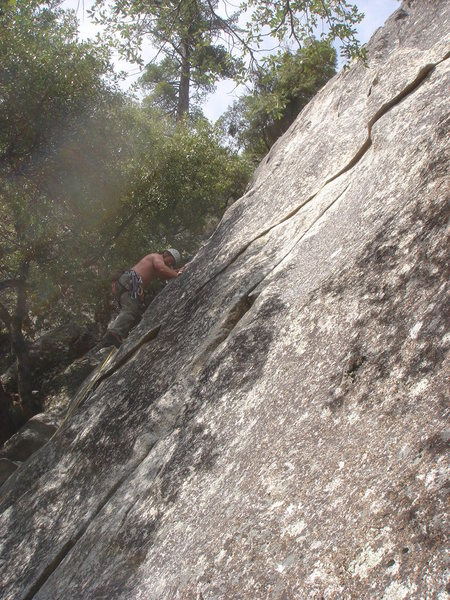 Day 5 - On the crux of Just for Starters (5.10a), Knob Hill.<br> <br> Photo by Sandra