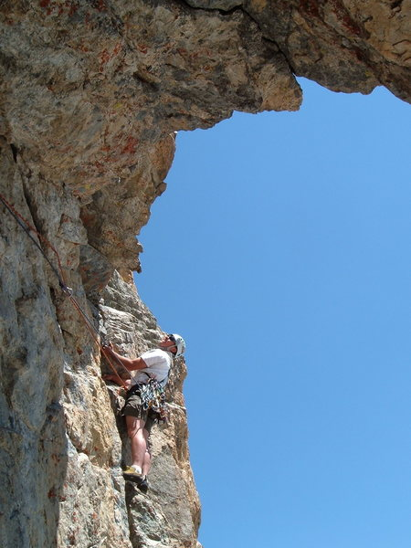 Dan Carson leading below the huge roof on the fourth pitch.