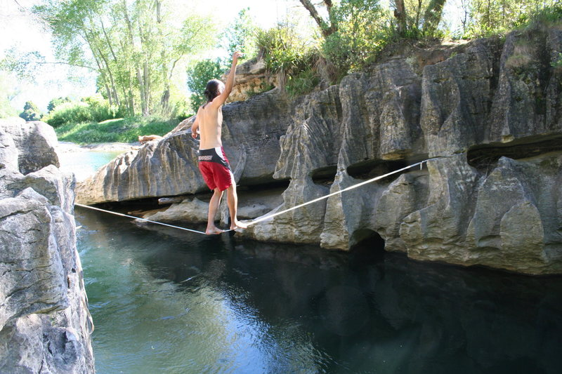 leon on a slack line set up at the Second Watering Hole (november 2007).  The idea was not to fall withing the first couple feet...to clear the rock and hit the water.  hmmm. slack at your own risk.