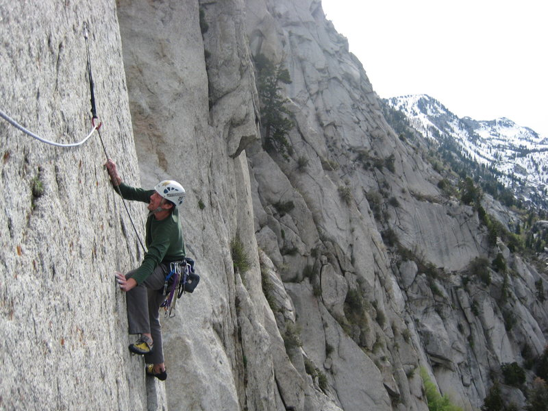 Grk enters the traverse to the first belay on Cymbals.
