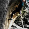 """Jim Hausmann making the 1999 F.A. on the ultra classic """"Pac-man (V7).""""  The Egg's.<br> Three Sister Park, Colorado."""