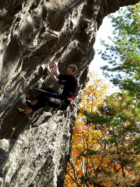 Engaged in the crux on a brisk fall afternoon.