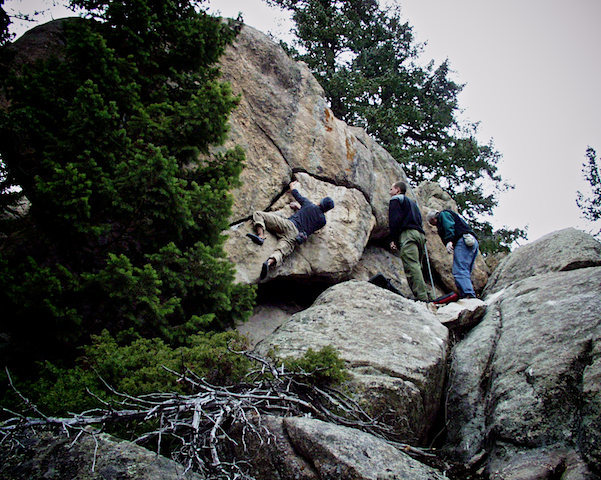 """Justin Hausmann making the F.A. of """"Sickle.""""  Three Sister Park, Colorado."""