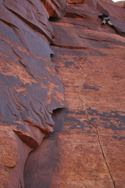 Unnamed 5.11- is the flake on the left, not the route with the climber.