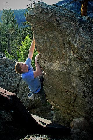 "Luke Childers climbing ""Peg Leg"" at the Pirates Cove area."