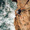 Tristan, 7, climbing his first sea cliff