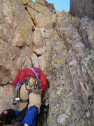Rock Climbing Photo: Erik gears up below the cleft chimney.  The pin is...