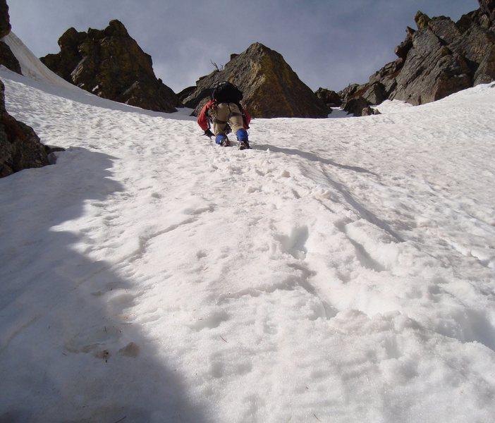 Erik ascending the final snow to the ridge top. Pitch 5.