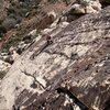 Pleasant slab climbing just below the varnished headwall.