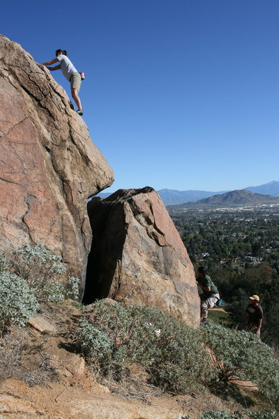 Agina on the upper section and Albert starting the bottom on another boulder in the Accomazzo Boulders area.