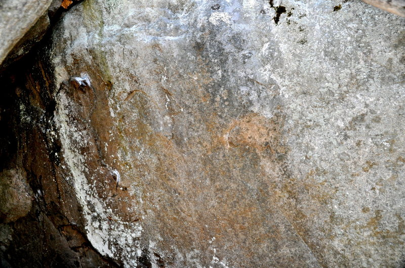 Vag Badger sit starts of the left side in the cave & traverses right to a jug. Flat, angular holds.  Rock is very different from Poppy Cock adjacent to it.
