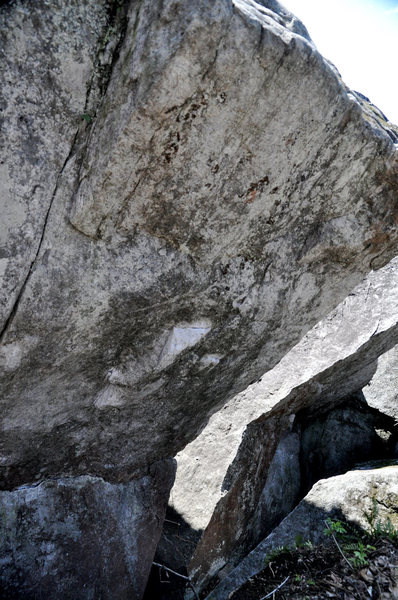 Counselor Moon climbs the right side of the overhanging face of the Slab side of the split boulder...confusing?