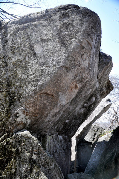 This climbs the thin holds on the arete of the slab & overhang
