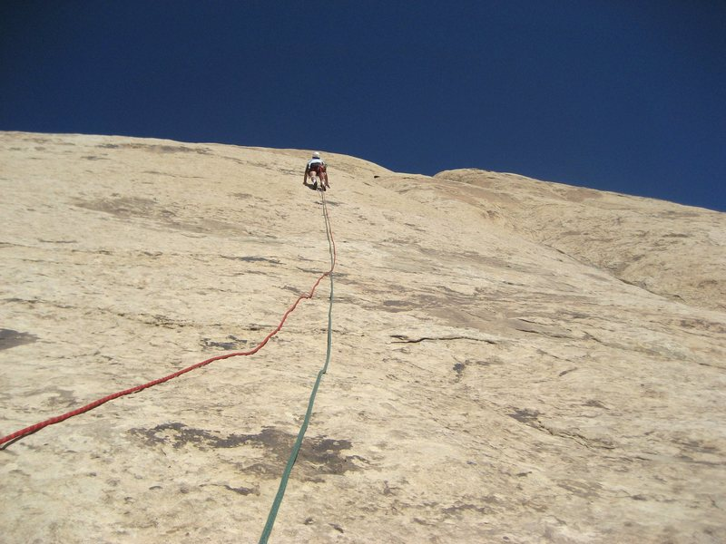 Paul starting the crux section of pitch three.