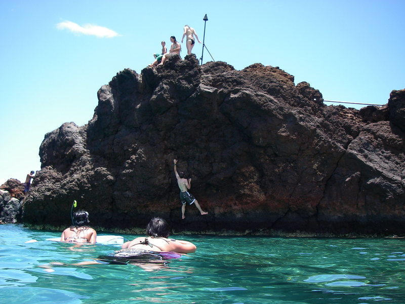 Fun water soloing on sharp lava rock.