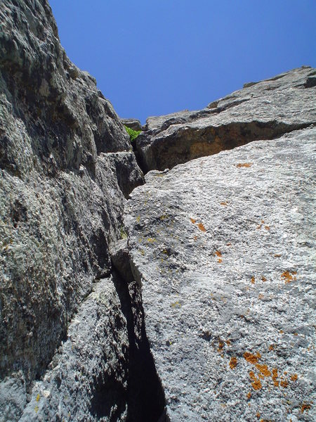Foreshortened view of P2 & P3 on the CMC Route.  Aim for the notch in the rock on the skyline.