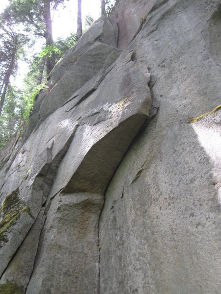 Them (5.9) underclings out the large flake, and then layback and jams up the right side.
