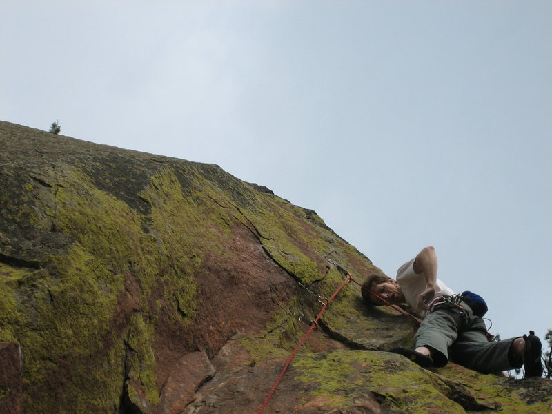 Taking a breather while assessing the gear situation just before the crux on the FA.