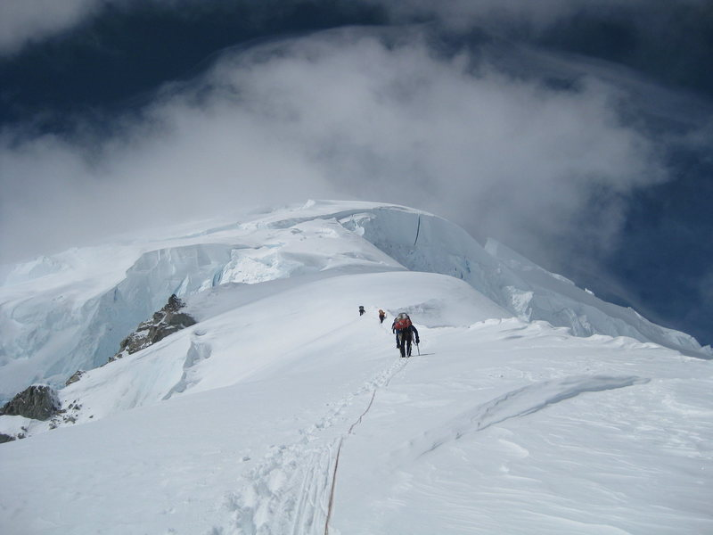 Looking up the heavily-crevassed slopes above 12,000 ft